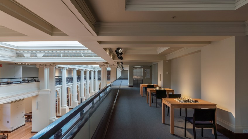 mezzanine view of library space with tables