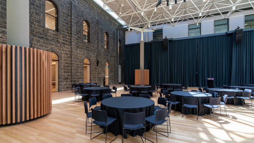 empty lecture forum with round tables