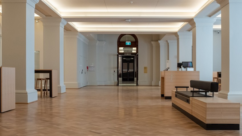 empty public hall with pillars and recessed lighting