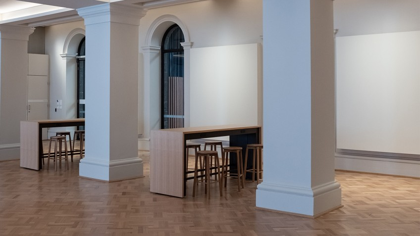 hall with pillars and parquetry floor