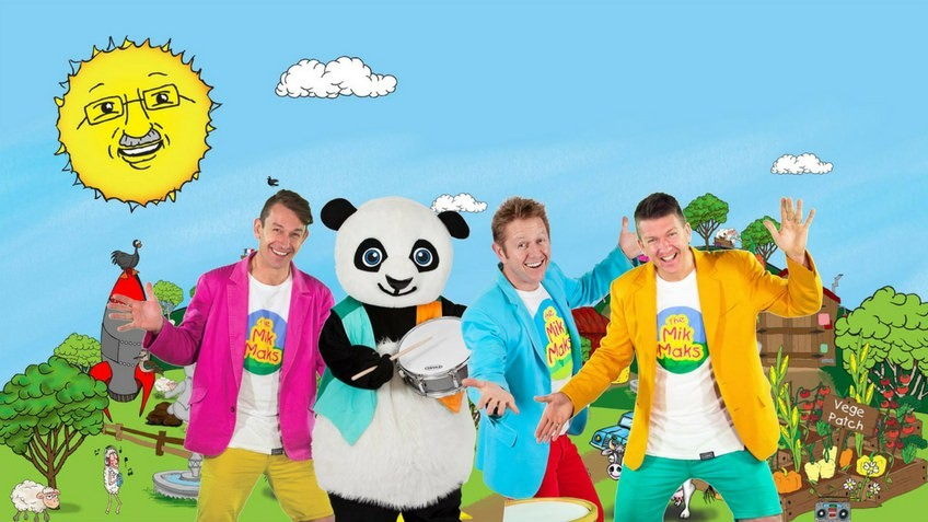 Three happy men and a panda playing a drum
