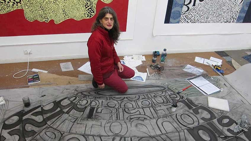 Photo of Angela Cavalieri, artist in studio, with work in progress Amore, 2013