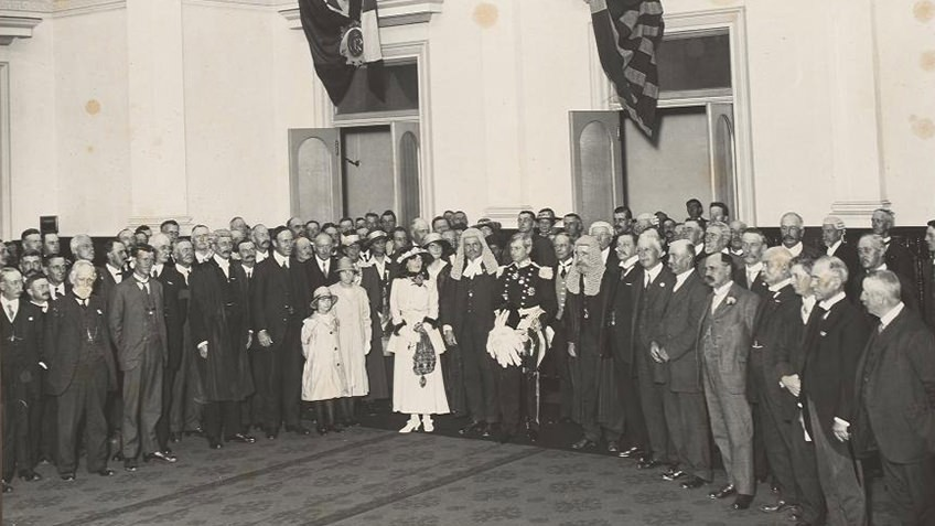 photo of dignitaries and officials with flags