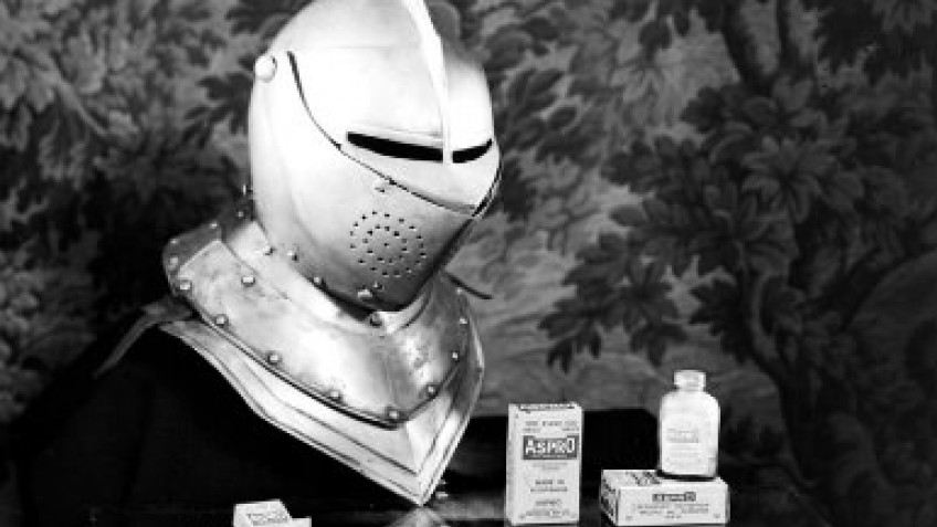 Armour helmet with bottles and packets of Aspro