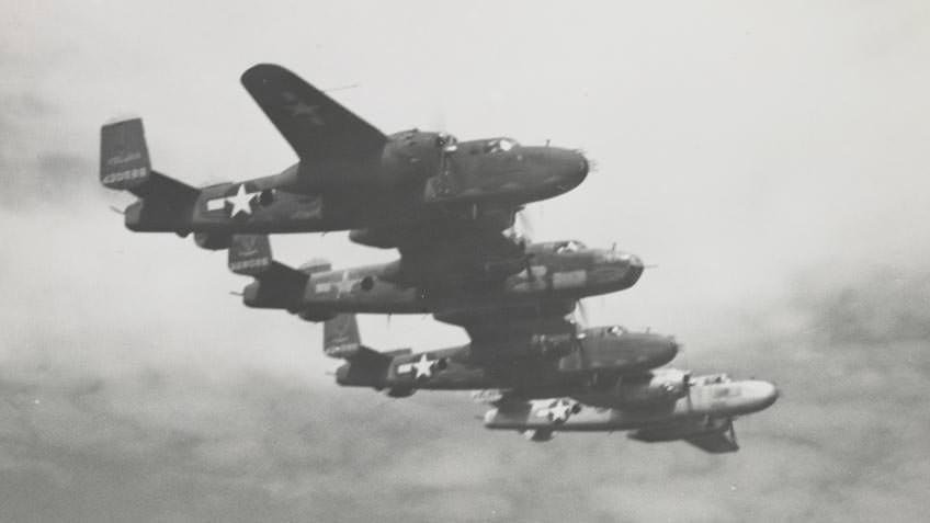 Four B17 bombers in flight during World War II, probably near Borneo
