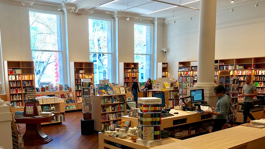 Readings bookshop in Russell Street Welcome Zone with large windows, wooden shelving and books