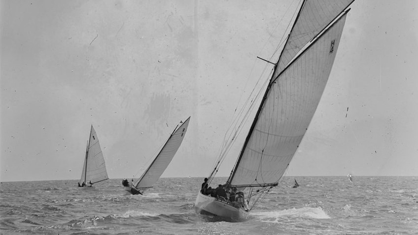 Black and white photo of 3 yachts on the ocean