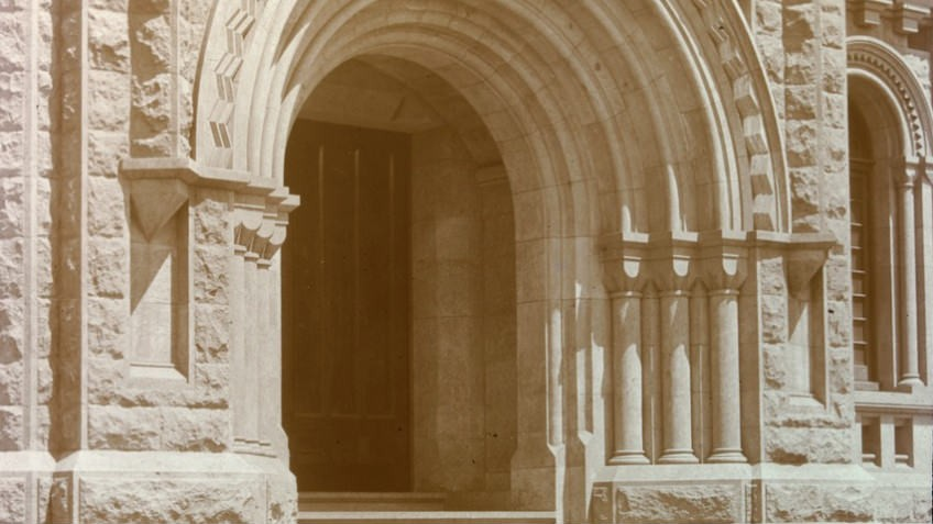 sepia photo of neo-Gothic doorway