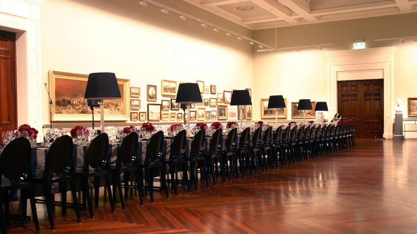 Photo of a long table set up in Cowen gallery