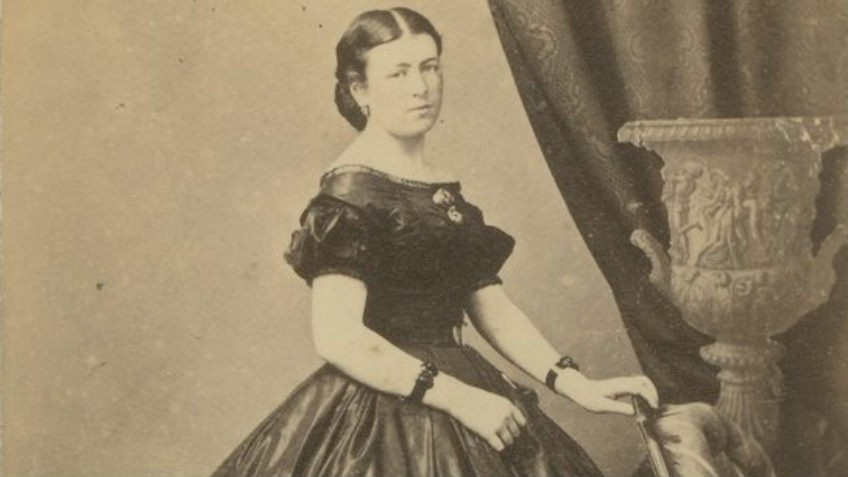Victorian portrait of woman wearing wide-skirted dress