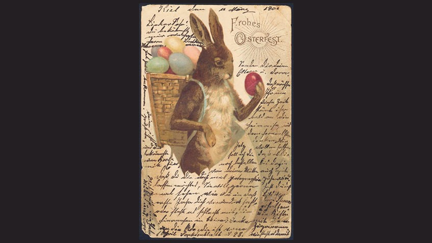 black background with vintage Easter card with rabbit holding eggs