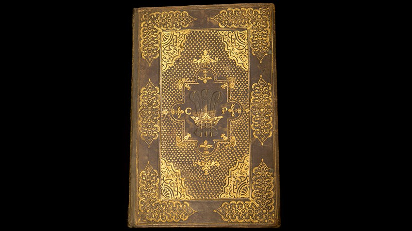 colour photo of leather and gilt historical volume Collected writings of King James I with personalised binding for Prince Charles, London, 1616
