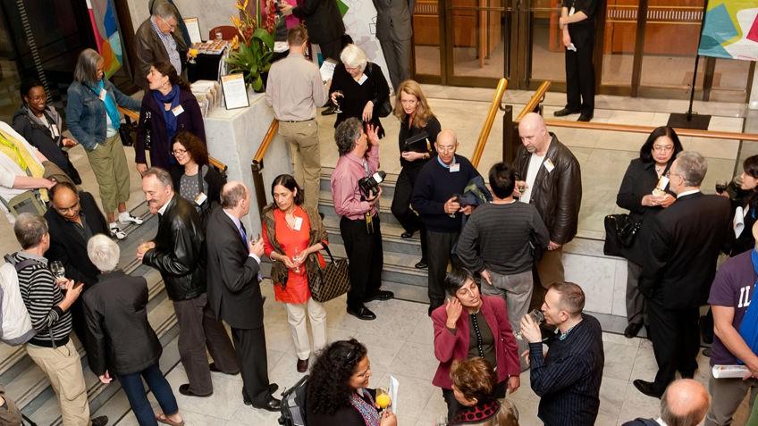 Photo looking down onto the foyer of the conference centre, showing people talking