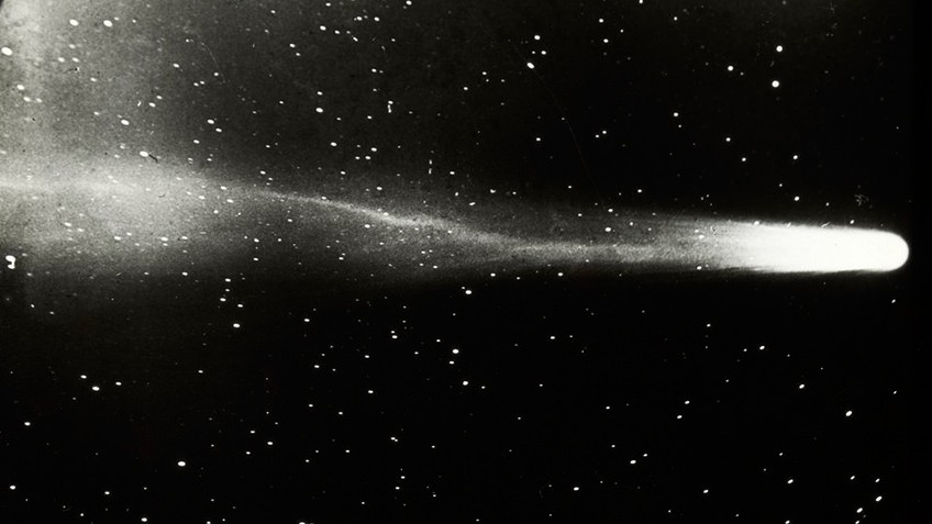 Black and white photo of comet streaking across the night sky
