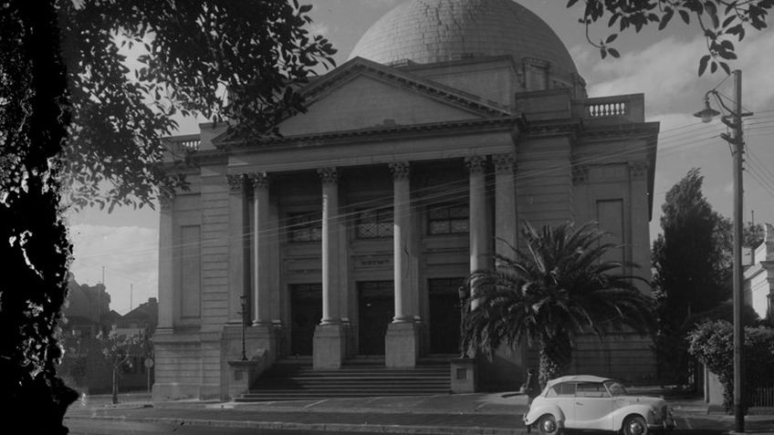 Building with domed roof and columned portico