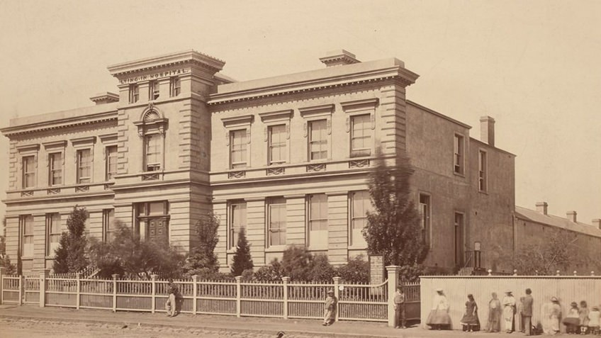 Sepia photograph of grand georgian building that takes up a city block