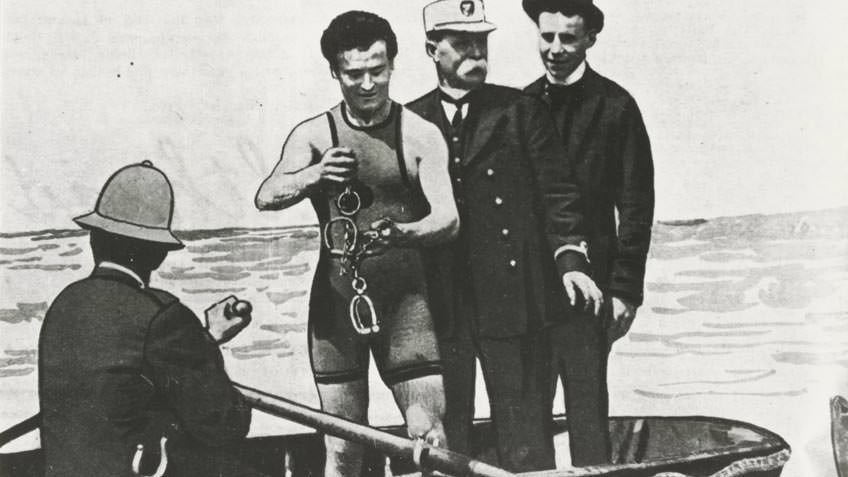 Harry Houdini on a boat in the Yarra River, WG Alma Conjuring Collection