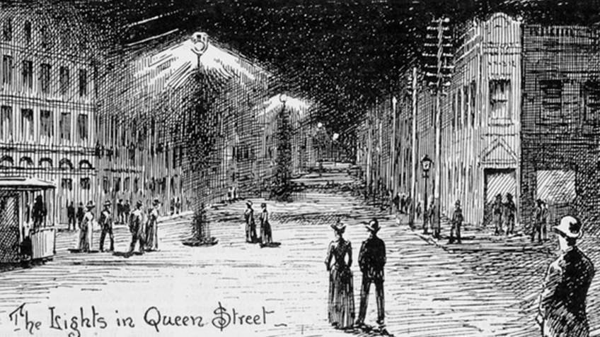 19th-century newspaper illustration of people in night street scene illuminated by street lights