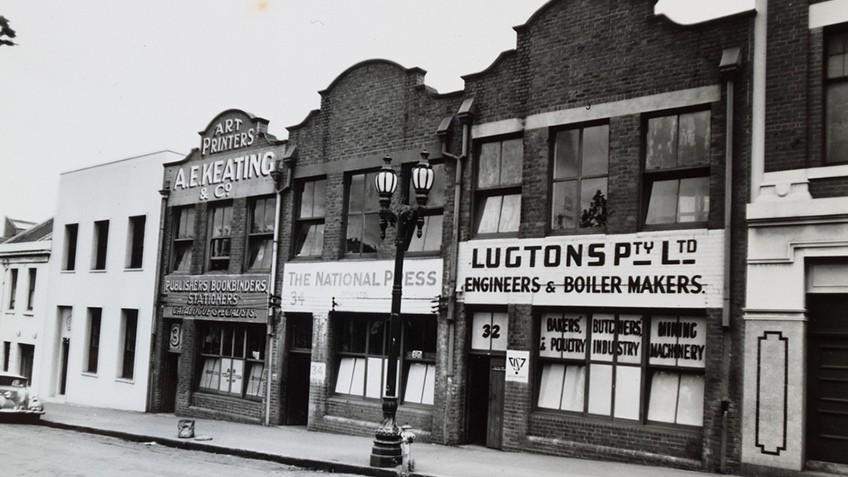 black and white photograph of Victorian-era buildings taken in the 1950s, converted into warehouses and factories