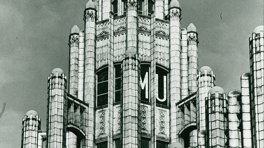 Black and white photo of the top of the Manchester Unity Building