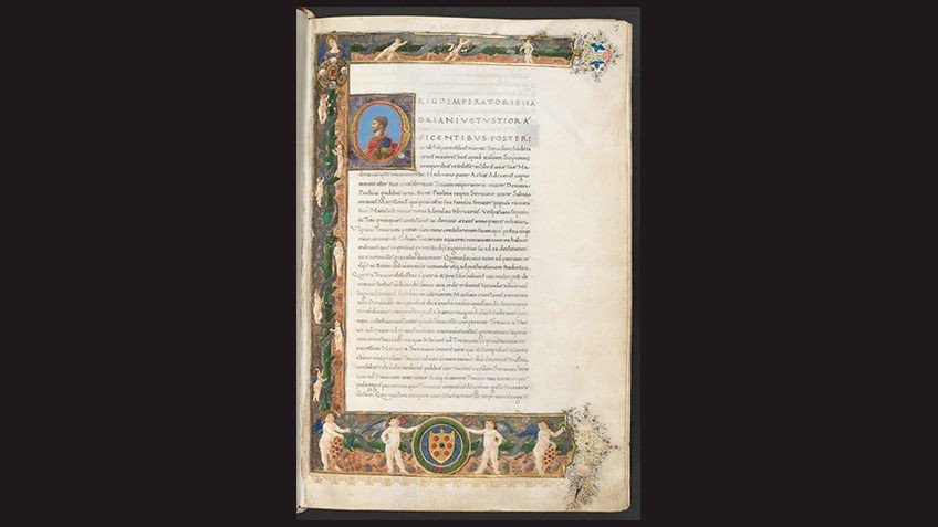 page from medieval manuscript against black background bordered with cherubs