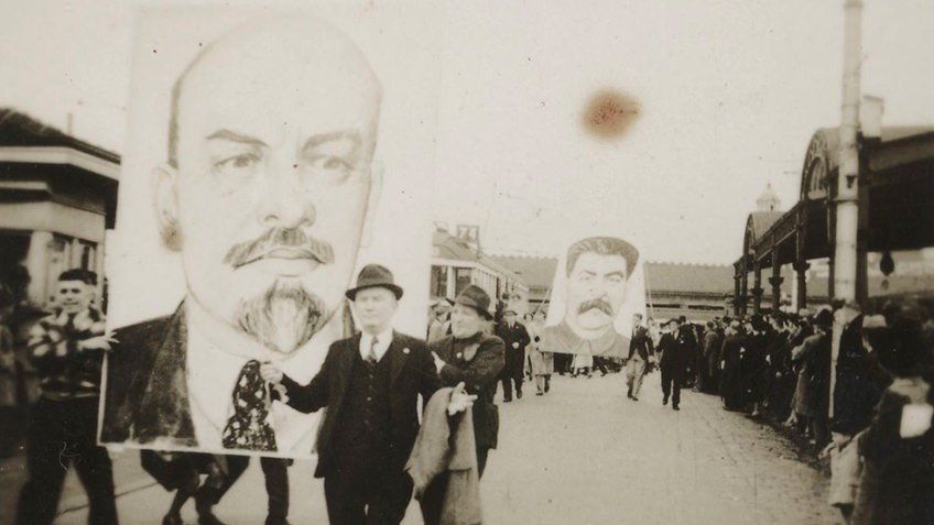 people marching with banners of Lenin and Stalin