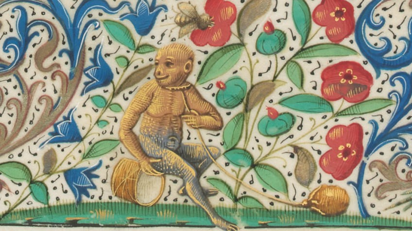 detail of medieval manuscript with monkey