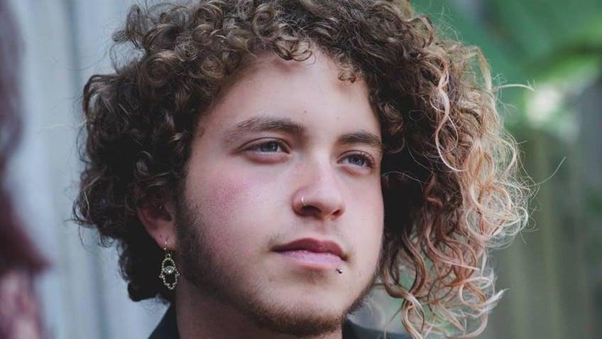 Head shot of transgender author Nevo Zisin
