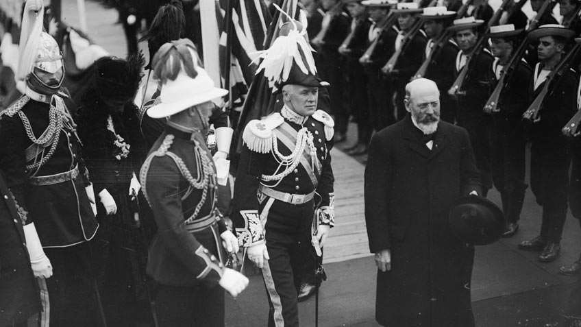 The Prime Minister and Governor General inspecting a line of sailors