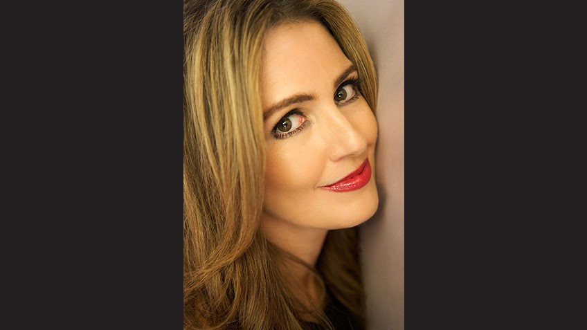 Cropped head shot against black background of blonde Young Adult author Jennifer Niven