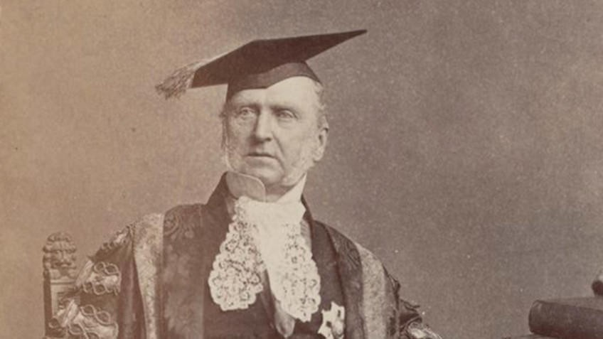sepia photo of Sir Redmond Barry in Chancellor's robes