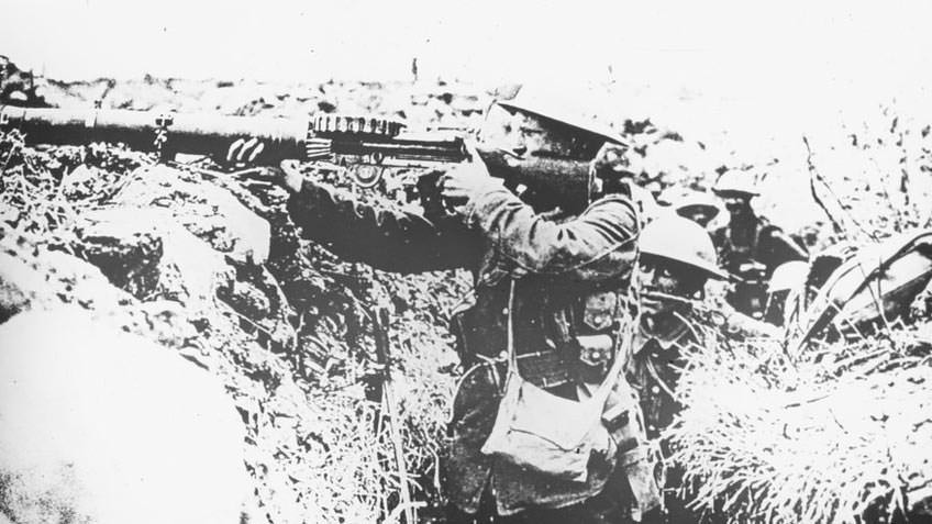 Soldier in Trench Firing Lewis