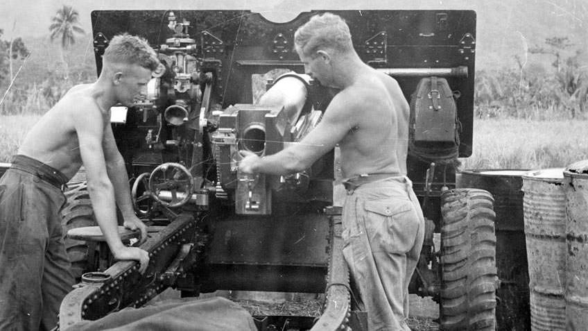Soldiers operating a 25-pounder field gun against the Japanese in the Dagua area