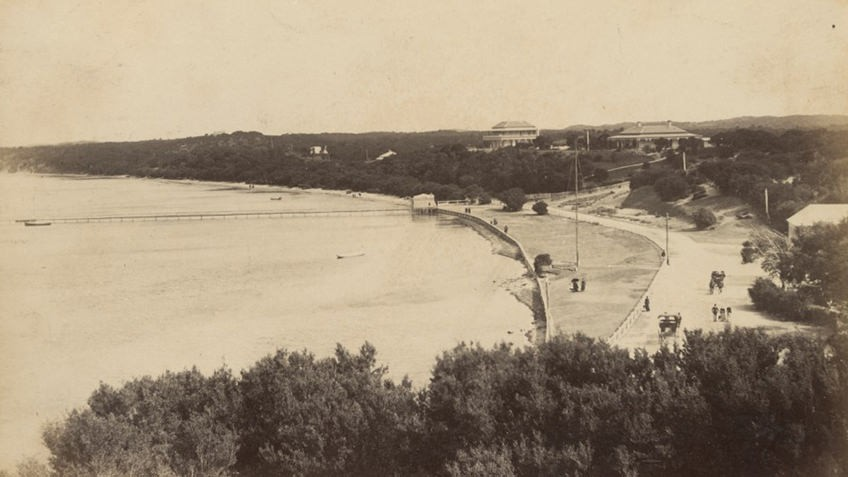 sepia photo of bay beach with coastal promenade and Victorian-era hotels