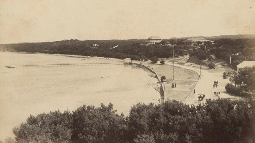 sepia photo of bay beach with coastal promenade and Victorian-era hotels