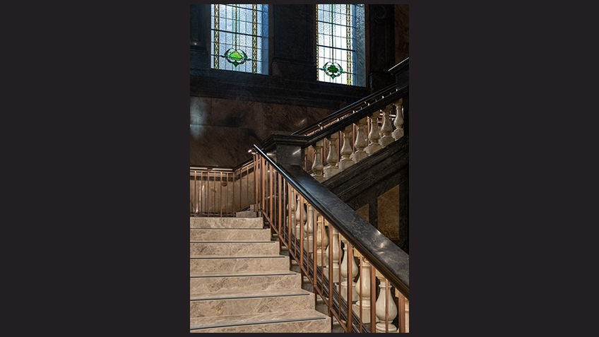 marble staircase with stained-glass windows