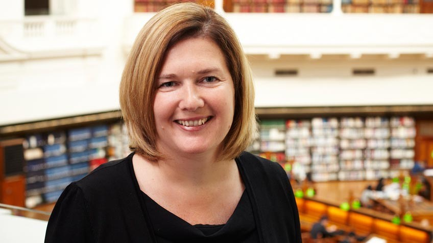 colour portrait of Sue Roberts, State Library Victoria CEO and State Librarian, 2012–15, with La Trobe Reading Room backdrop, by Andrew Lloyd 2012