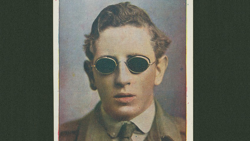 Sepia photo of man wearing black goggles for the blind