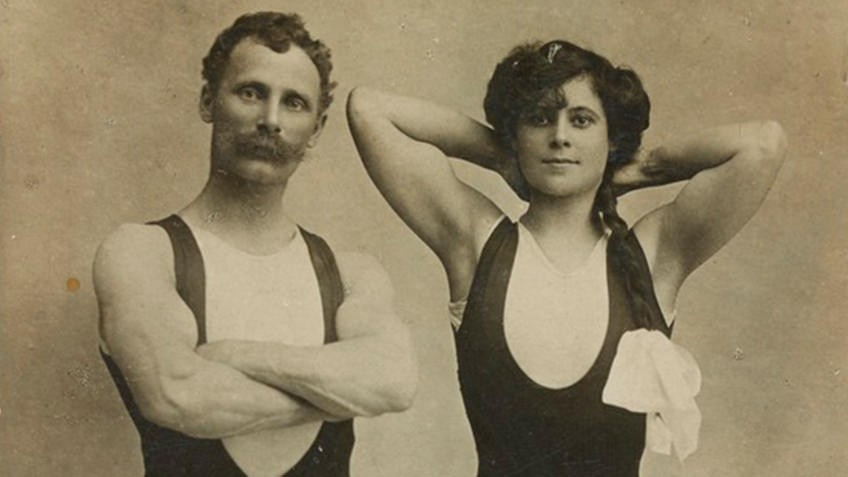 Vintage early 20th-century photo of male and female vaudeville acrobat duo