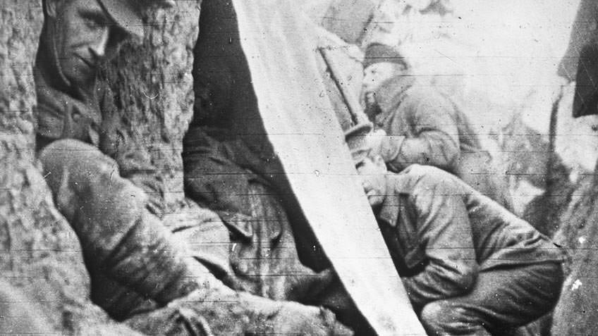 World War I soldiers take cover in a trench