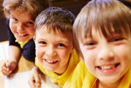 Smiling young schoolboys wearing yellow T-shirts