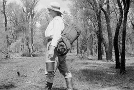 Black and white photo of a women walking in the Australian bushland
