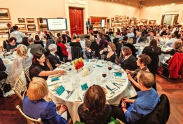 Colour photo of seated diners at Cowen Gallery event, State Library Victoria