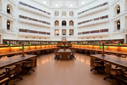 Horizontal view of reading desks and gallery balconies in octagonal reading room
