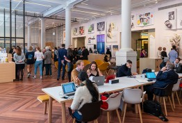 Library Russell Street foyer with cafe customers, whie pillars and people at desks