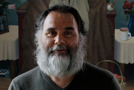 A bearded, smiling man