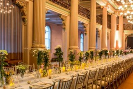 Elegant Queen's Hall gallery with classical pillars, chandeliers and formal tables set for a reception