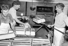 Australian Army bakers stacking the bread ready for distribution during World War II