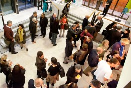 Photo of the conference centre foyer, showing people talking