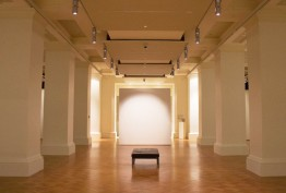 Photo of an empty Keith Murdoch Gallery, with parquetry flooring and white columns on either side
